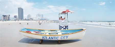side view of person rowing in boat - Lifeguard station on beach, Atlantic City, New Jersey, USA Stock Photo - Rights-Managed, Code: 700-06939621