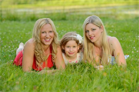 daughter middle-aged mother women young adults - Cloase-up of Woman with her daughter and her mother in summer, Bavaria, Germany. Stock Photo - Rights-Managed, Code: 700-06939634