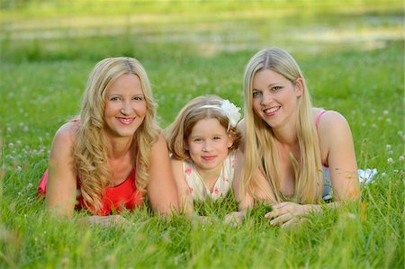 daughter middle-aged mother women young adults - Close-up of a woman with her daughter and her mother in summer, Bavaria, Germany. Stock Photo - Rights-Managed, Code: 700-06939635