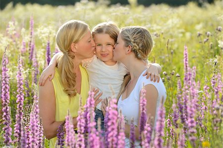 daughter middle-aged mother women young adults - Close-up of a woman with her daughter and her mother in a flower meadow in summer, Bavaria, Germany. Stock Photo - Rights-Managed, Code: 700-06939636
