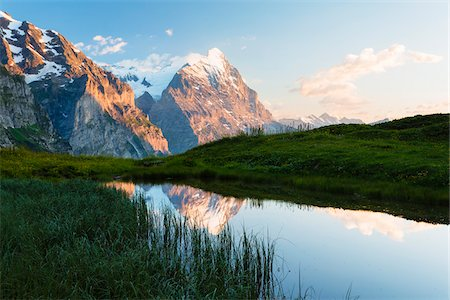 snow capped - Reflection in Pond with Wetterhorn and Eiger Peak, Grosse Scheidegg, Bernese Alps, Switzerland Stock Photo - Rights-Managed, Code: 700-06964175