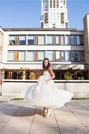 Portrait of Bride twirling in dress outdoors in City Park, Toronto, Ontario, Canada Stock Photo - Rights-Managed, Code: 700-06960996
