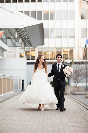 Bride and Groom walking towards camera along walkway in City Park on Wedding Day, Toronto, Ontario, Canada Stock Photo - Rights-Managed, Code: 700-06960991