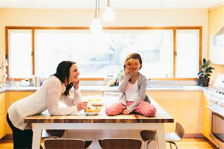 funny looking people - Mom and daughter in a modern kitchen, Oregon, USA Stock Photo - Rights-Managed, Code: 700-06961896