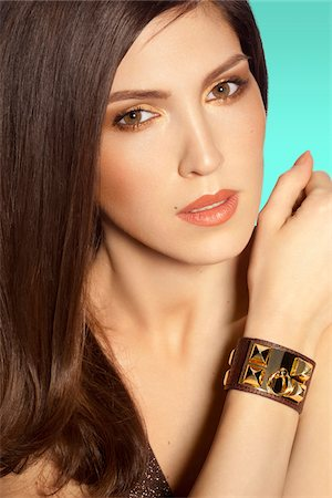 Close-up Portrait of Woman wearing bracelet, studio shot Stock Photo - Rights-Managed, Code: 700-06961978