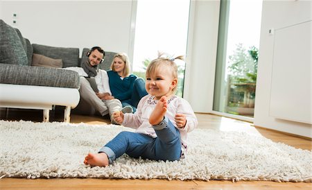 Family Relaxing in Living Room, Mannheim, Baden-Wurttemberg, Germany Stock Photo - Rights-Managed, Code: 700-06962016