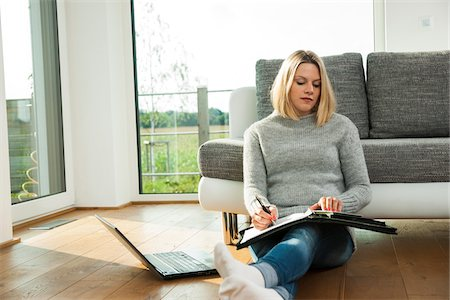 sweater - Young Woman Working at Home, Mannheim, Baden-Wurttemberg, Germany Stock Photo - Rights-Managed, Code: 700-06962038