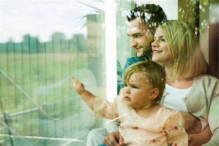 Family Looking out Window at Home, Mannheim, Baden-Wurttemberg, Germany Stock Photo - Rights-Managed, Code: 700-06962031