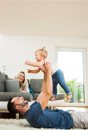 Family in Living Room at Home, Mannheim, Baden-Wurttemberg, Germany Stock Photo - Rights-Managed, Code: 700-06962050