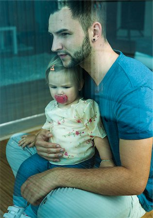 Baby Girl sitting on Father's Lap at Home, Mannheim, Baden-Wurttemberg, Germany Stock Photo - Rights-Managed, Code: 700-06962061