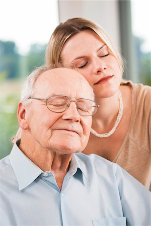 Young Woman and Senior Man with Eyes Closed, Mannheim, Baden-Wurttemberg, Germany Stock Photo - Rights-Managed, Code: 700-06962184