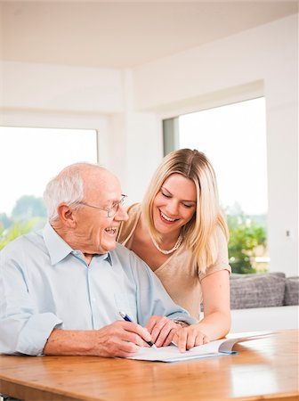 form - Young Woman and Senior Man looking at Document, Mannheim, Baden-Wurttemberg, Germany Stock Photo - Rights-Managed, Code: 700-06962187