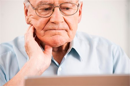 Senior Man using Laptop at Home, Mannheim, Baden-Wurttemberg, Germany Stock Photo - Rights-Managed, Code: 700-06962181