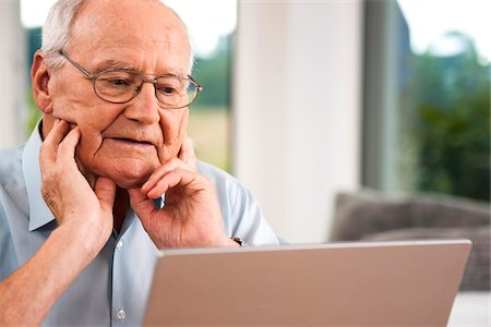 Senior Man using Laptop at Home, Mannheim, Baden-Wurttemberg, Germany Stock Photo - Rights-Managed, Code: 700-06962182