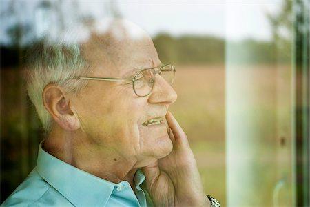 Portrait of Senior Man through Window, Mannheim, Baden-Wurttemberg, Germany Stock Photo - Rights-Managed, Code: 700-06962204