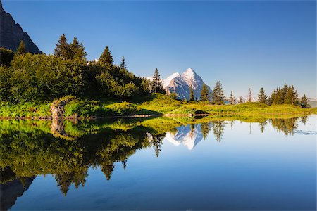 Reflection of Eiger Peak in an Alpine Lake at Sunrise, Bernese Alps, Grosse Scheidegg, Canton of Bern, Switzerland Stock Photo - Rights-Managed, Code: 700-07026609