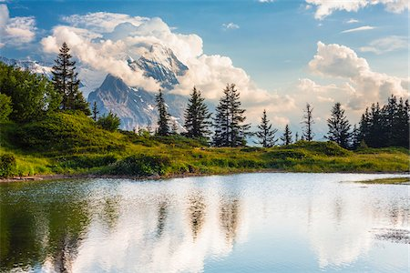 Alpine Lake and Storm Clouds at Mount Eiger, Bernese Alps, Canton of Bern, Switzerland Stock Photo - Rights-Managed, Code: 700-07026617