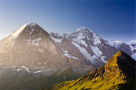 snow capped - View from Kleine Scheidegg on Mount Eiger, with Monch and Jungfrau at Sunrise, Bernese Alps, Switzerland Stock Photo - Rights-Managed, Code: 700-07066997