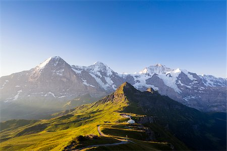 View from Kleine Scheidegg on Mount Eiger, with Monch and Jungfrau at Sunrise, Bernese Alps, Switzerland Fotografie stock - Rights-Managed, Codice: 700-07066999