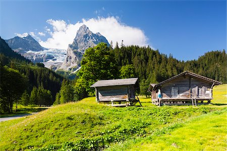 Alpine Huts on Meadow with Mount Wellhorn and Rosenlaui Glacier in the background, Bernese Alps, Switzerland Stock Photo - Rights-Managed, Code: 700-07067005