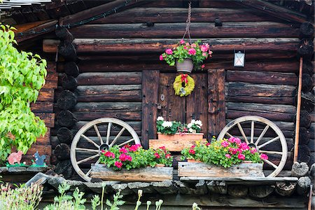 Two Old Carriage Wheels at Log House with Flowers for Decoration, Murren, Bernese Oberland, Switzerland Stock Photo - Rights-Managed, Code: 700-07067000