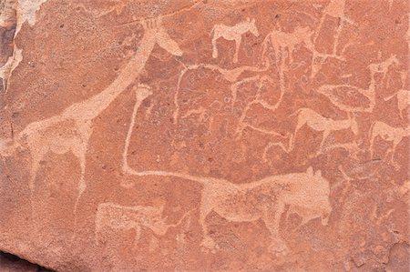 prehistoric - Close-up of Petroglyphs (or rock engravings), Twyfelfontein, UNESCO World Heritage site, Damaraland, Kunene Region, Namibia, Africa Stock Photo - Rights-Managed, Code: 700-07067068