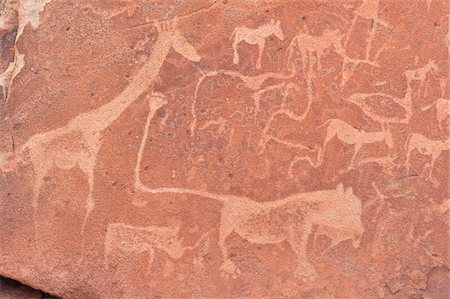 prehistoric - Close-up of Petroglyphs (or rock engravings), Twyfelfontein, UNESCO World Heritage site, Damaraland, Kunene Region, Namibia, Africa Stock Photo - Rights-Managed, Code: 700-07067068