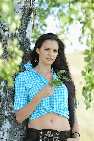 dark hair - Portrait of young woman standing beside tree, Bavaria, Germany Stock Photo - Rights-Managed, Code: 700-07067362