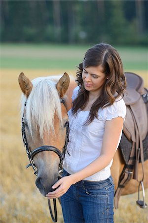 dark hair - Young Woman Standing beside Haflinger, Bavaria, Germany Stock Photo - Rights-Managed, Code: 700-07067522