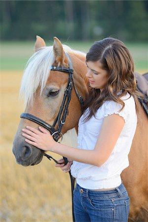 dark hair - Young Woman standing beside Haflinger, Bavaria, Germany Stock Photo - Rights-Managed, Code: 700-07067523