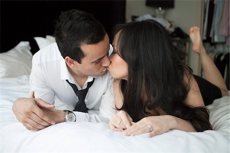 Close-up of couple in bed, kissing Stock Photo - Rights-Managed, Code: 700-07062778