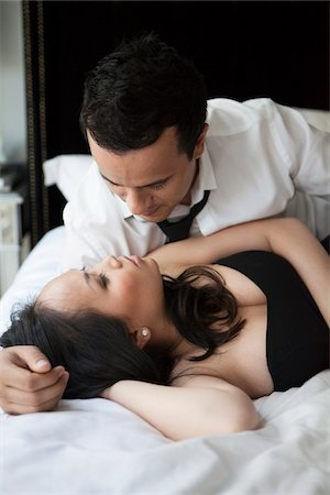 sexy - Close-up of couple laying in bed, looking at each other Stock Photo - Rights-Managed, Code: 700-07062779