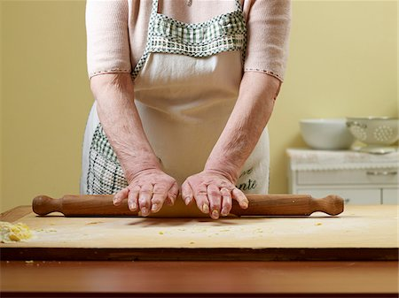 Elderly Italian woman making pasta by hand in kitchen, rolling dough, Ontario, Canada Stock Photo - Rights-Managed, Code: 700-07108321