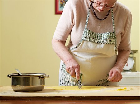 Elderly Italian woman making pasta by hand in kitchen, working with dough, Ontario, Canada Stock Photo - Rights-Managed, Code: 700-07108335