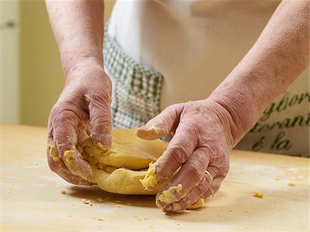 Close-up of elderly Italian woman's hands kneading pasta dough in kitchen, Ontario, Canada Stock Photo - Rights-Managed, Code: 700-07108332