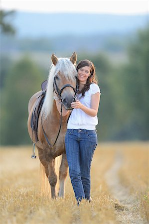 dark hair - Young Woman Standing beside Haflinger Horse in Threshed Cornfield, Bavaria, Germany Stock Photo - Rights-Managed, Code: 700-07110696