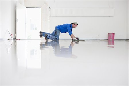 floor - Tradesman Working on new Floor Cover in Garage, Mulheim, North Rhine-Westphalia, Germany Stock Photo - Rights-Managed, Code: 700-07110693