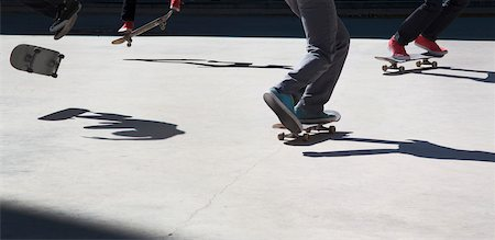 Close-up of multiple skateboarders practicing moves, downtown Toronto, Ontario, Canada Stock Photo - Rights-Managed, Code: 700-07122852