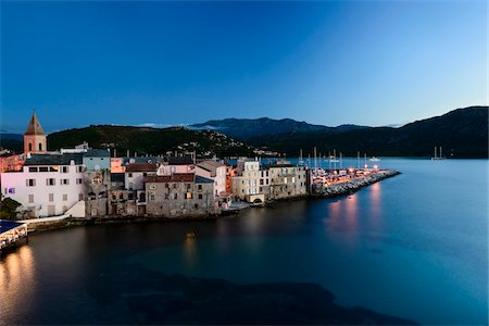 Scenic view of the old town and port at dusk, Nebbio, Saint-Florent, Corsica, France Stock Photo - Rights-Managed, Code: 700-07148249