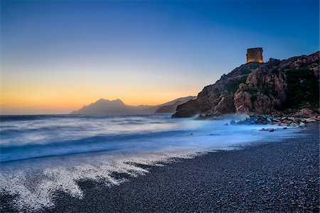 Scenic view of beach, surf and Genoese Watchtower at sunset, Gulf of Porto, Corsica, France Stock Photo - Rights-Managed, Code: 700-07148240