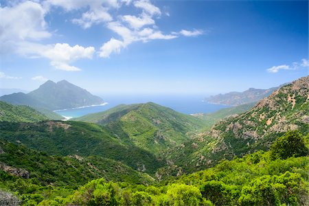 rugged landscape - Scenic view of mountains, Girolata Gulf, in the background on the right Scandola Nature Reserve (a Unesco World Heritage Site) between Calvi, Porto and Galeria, Corsica, France Stock Photo - Rights-Managed, Code: 700-07148254