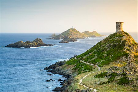 Scenic view of the Sanguinaires Islands, Genoese Watchtower and Pointe de La Parata (Parata Point), Gulf of Ajaccio, Corsica, France Photographie de stock - Rights-Managed, Code: 700-07148260