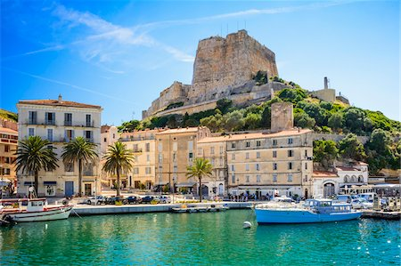 View of medieval fortress and the Citadel from the harbour, Bonifacio, Corsica, France Stock Photo - Rights-Managed, Code: 700-07148281