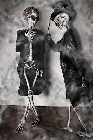 dead woman - Elegant Skeleton Greets a Charmed Lady Skeleton Stock Photo - Rights-Managed, Code: 700-07148323