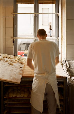 french (places and things) - Male baker shaping baguette bread dough by hand in bakery, Le Boulanger des Invalides, Paris, France Stock Photo - Rights-Managed, Code: 700-07156237