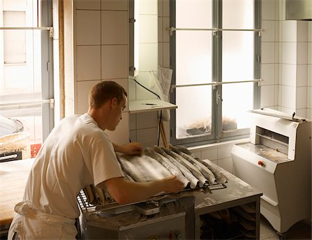 french (places and things) - Male baker shaping baguette bread dough by hand in bakery, Le Boulanger des Invalides, Paris, France Stock Photo - Rights-Managed, Code: 700-07156239