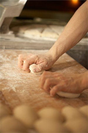 Close-up of male baker's hands kneading bread dough on floured board, Le Boulanger des Invalides, Paris, France Stock Photo - Rights-Managed, Code: 700-07156249