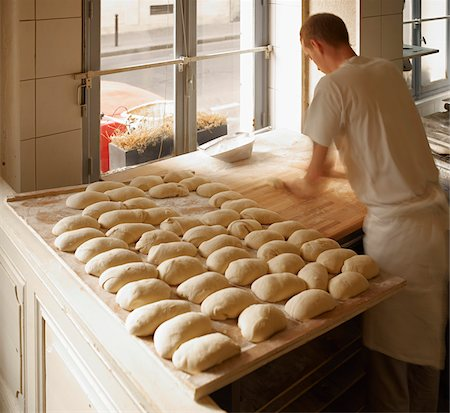 Male baker shaping baguette bread dough by hand in bakery, Le Boulanger des Invalides, Paris, France Stock Photo - Rights-Managed, Code: 700-07156240