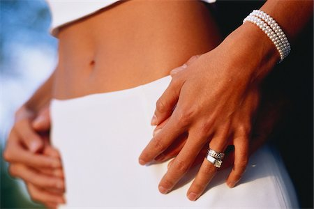 ring hand woman - Close-Up of Hands on Woman's Waist Stock Photo - Rights-Managed, Code: 700-07199492