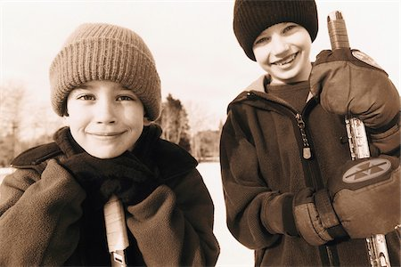 sports and hockey - Portrait of Two Boys with Hockey Sticks Outdoors Stock Photo - Rights-Managed, Code: 700-07199506